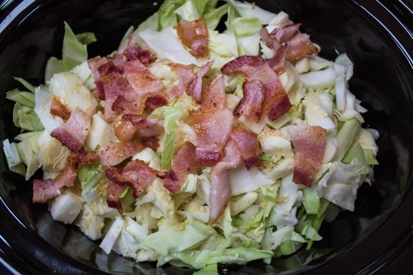 chopped cooked bacon added to the crockpot cabbage.