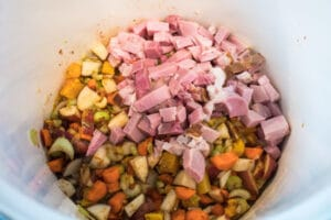 chopped ham added to seasoned vegetables.