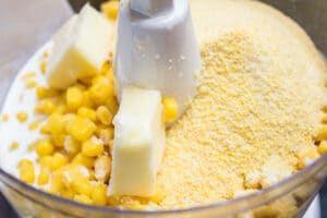 sweet corn, heavy cream, cornmeal, and butter in food processor.