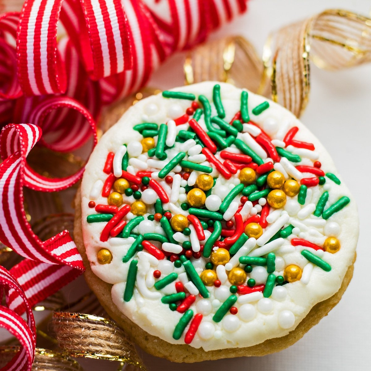 large square overhead image of Christmas cookies in ribbons.