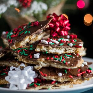large square sideview image of christmas crack saltine toffee.