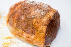 eye of round beef portion with seasoning rub ready to smoke.