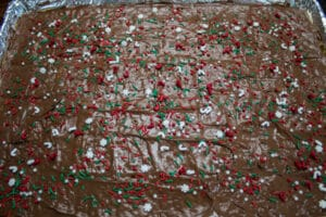 top the christmas crack saltine toffee with nuts or christmas sprinkles.
