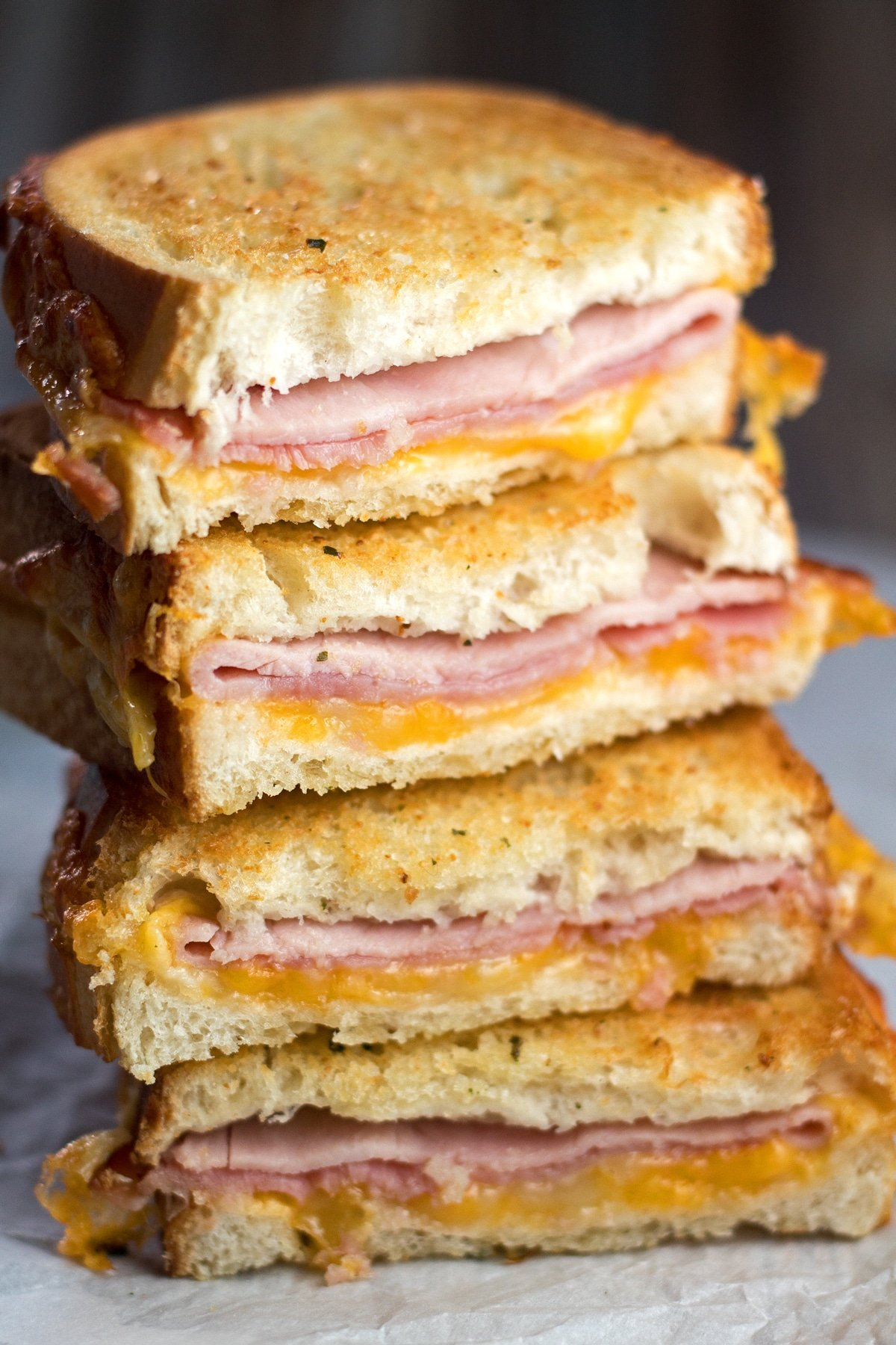 tall closeup image of the stacked air fryer grilled ham and cheese.