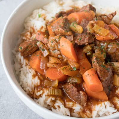 large square angled closeup of Hawaiian Beef Stew in white bowl.