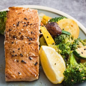 Large square hibachi salmon served with hibachi vegetables.