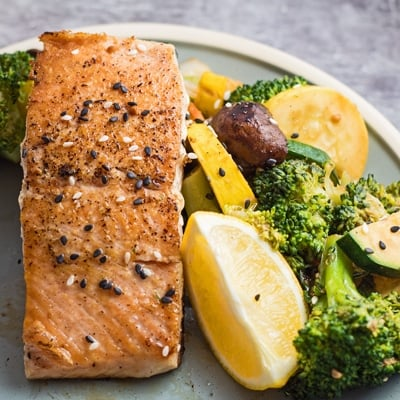 Hibachi salmon served with hibachi vegetables.