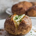 Large square image of tasty smoked baked potato with butter.