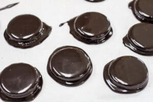 transfer the fudge coated oreos to parchment paper lined baking sheet.