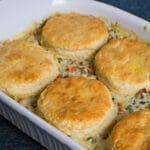 Overhead of biscuit chicken pot pie in casserole dish.