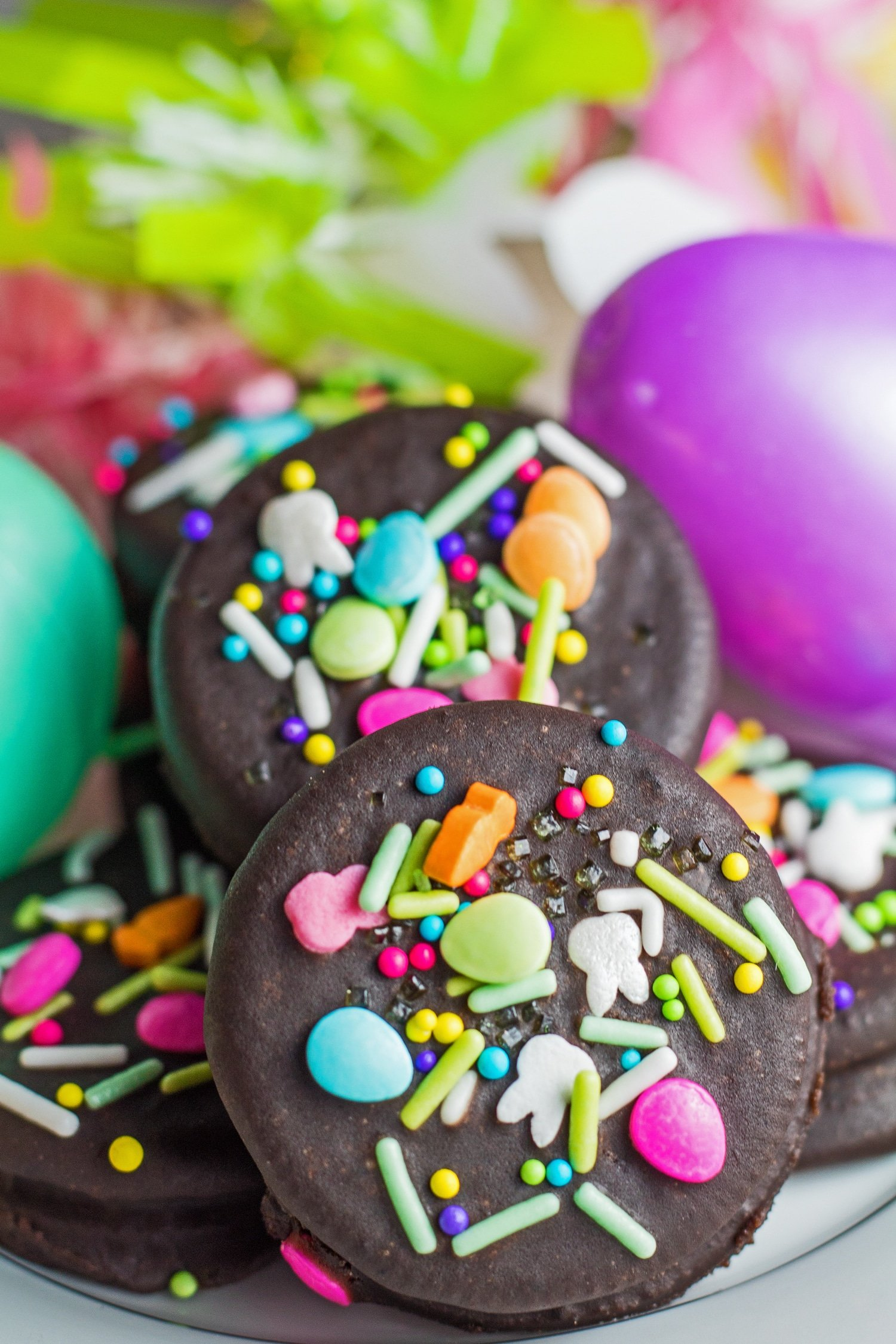 Tall image of the Easter Fudge Covered Oreos with decorative eggs.