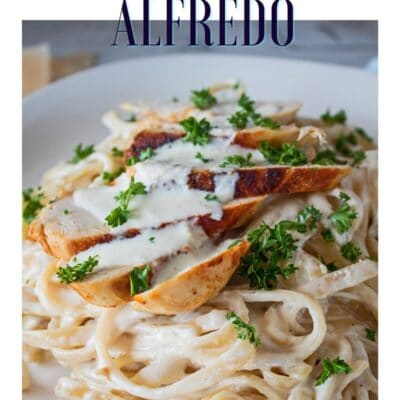 Pin with closeup of grilled chicken fettuccine alfredo and text header.