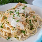 Grilled chicken fettuccine alfredo with sliced chicken served over pasta.