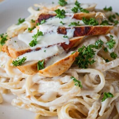 Closeup image of the dished grilled chicken fettuccine alfredo.