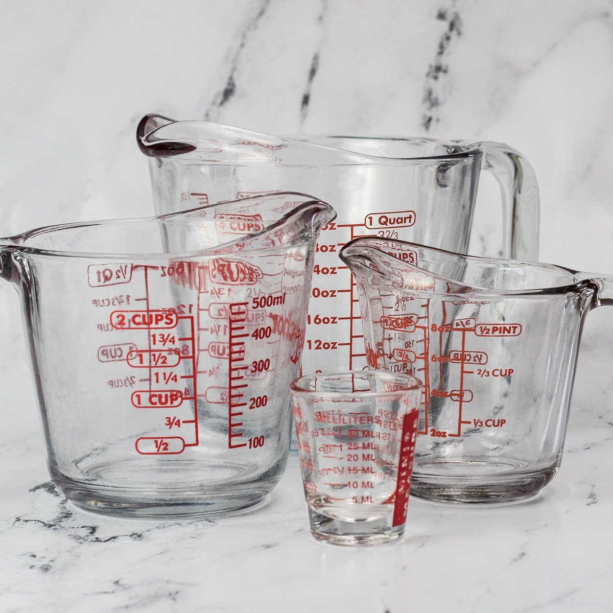 Liquid measuring cup sizes showing ounces in a quart.