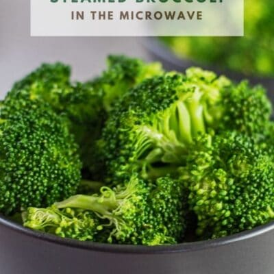 Pin with microwave steamed broccoli and text overlay.