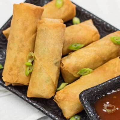 Perfectly crispy air fryer frozen spring rolls plated with dipping sauce.