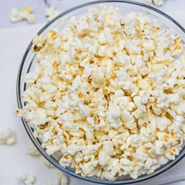 Air Fryer Popcorn served in clear bowl.