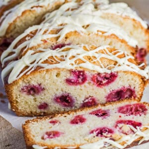 Sliced White Chocolate and Raspberry Loaf Cake with white chocolate drizzle.