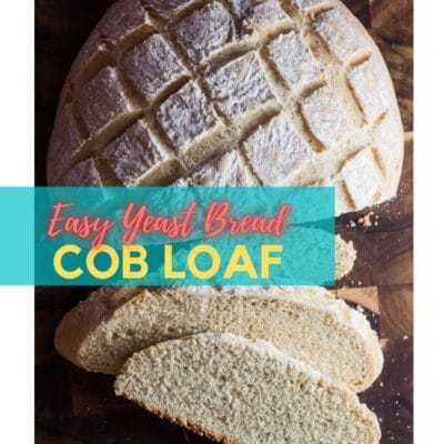 Pin of baked and sliced cob loaf with text overlay.