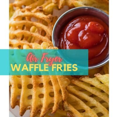 Air fryer waffle fries cooked and served with ketchup.