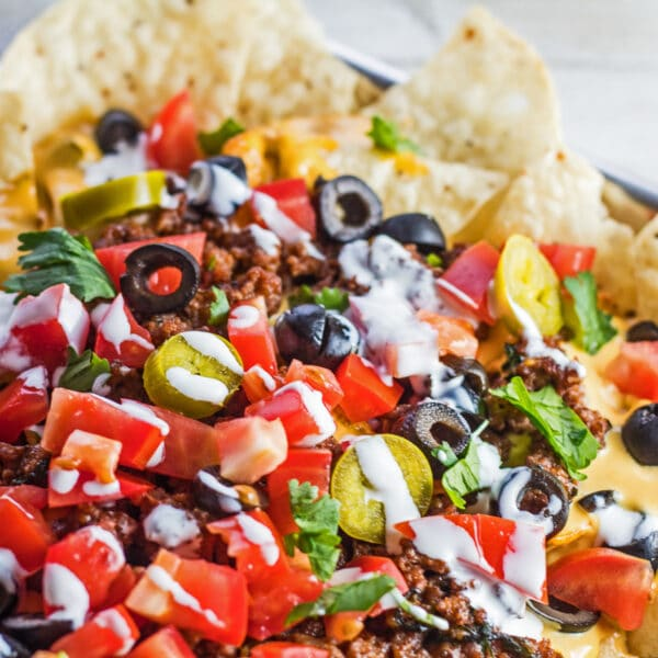 Loaded nachos supreme with nacho toppings.