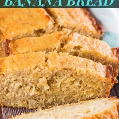 Pin with pineapple banana bread sliced and ready to serve.