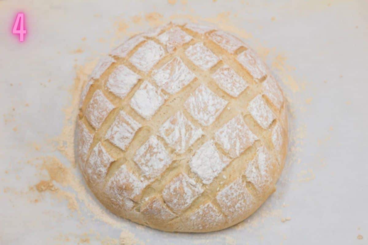 Process photo of the baked cob loaf after removing from the oven.