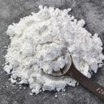 Loose tapioca starch on grey stone texture background.