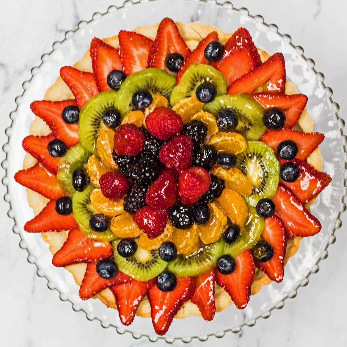Tarte aux Fruits overhead photo on glass plate.