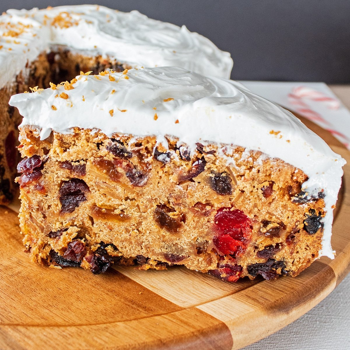 Christmas cake sliced and served on white plate.