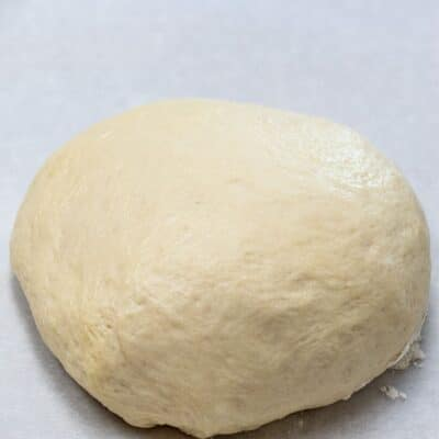 Homemade pizza dough pin with text header.
