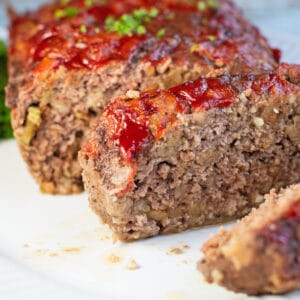 Quick and easy stove top meatloaf sliced and served on platter.
