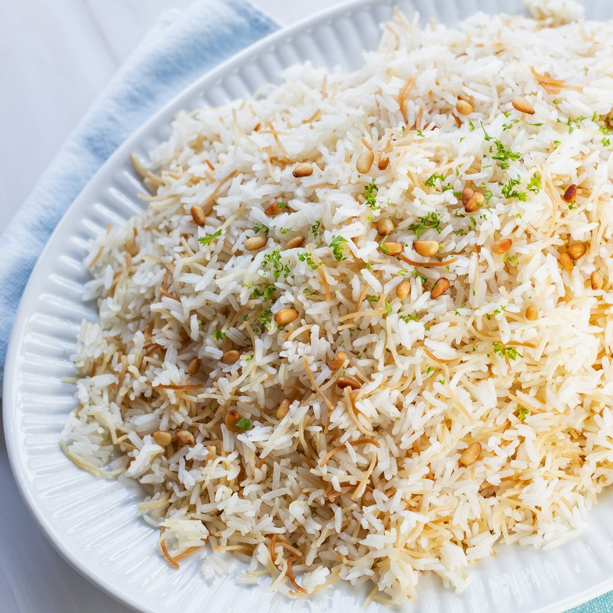 Beautiful and fragrant vermicelli rice served on large white platter.