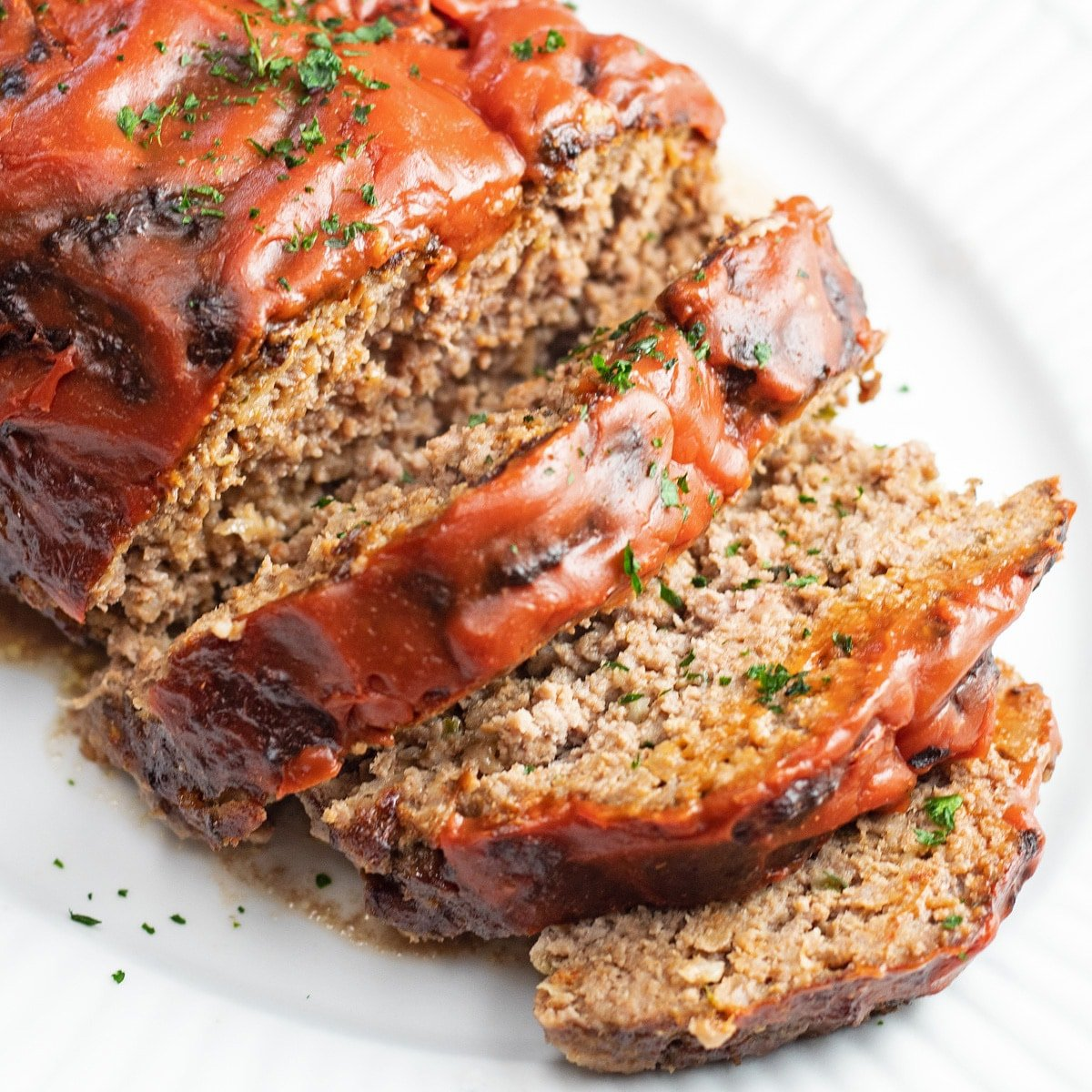 Sliced meatloaf ready for all your what to serve with meatloaf ideas.