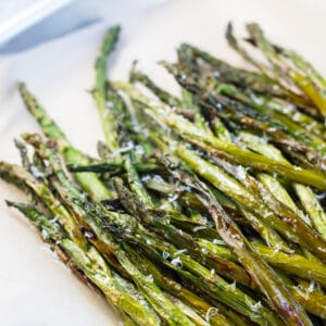 Air fryer asparagus roasted to perfection and served in tray.