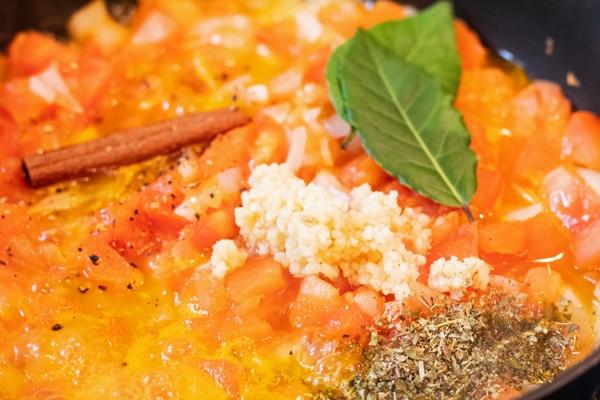 Process photo 2 of adding seasoning to the birria marinade.