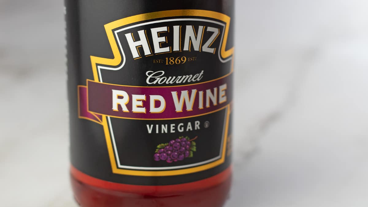 Bottled red wine vinegar on marbled background for red wine vinegar substitute.