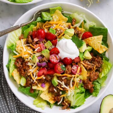 Taco salad served in white bowl.