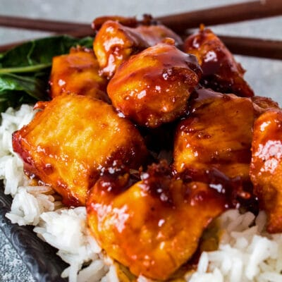 General Tso's chicken served over steamed rice with bok choy.