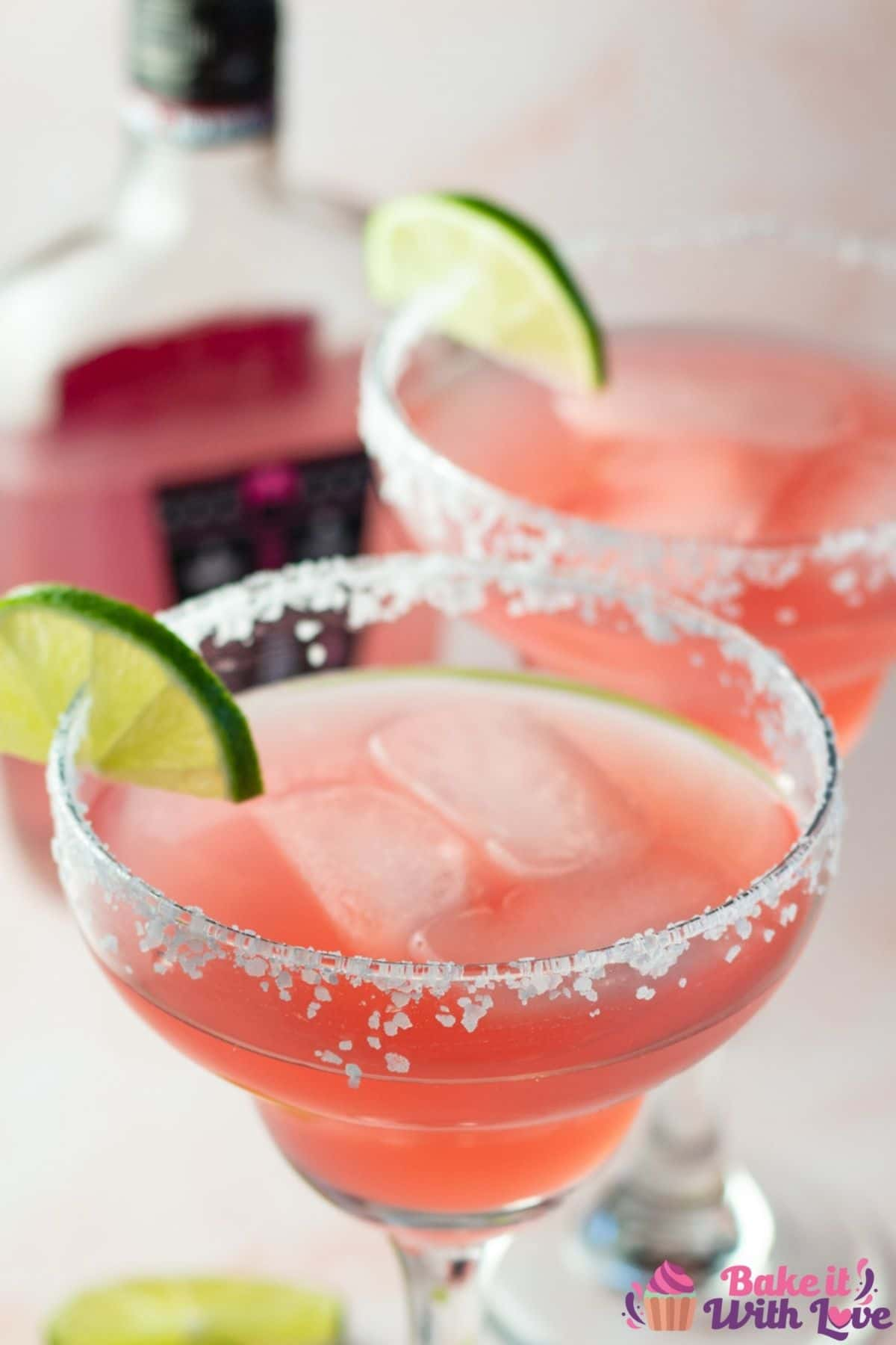 Pink vodka margaritas with Pink Whitney bottle in background.