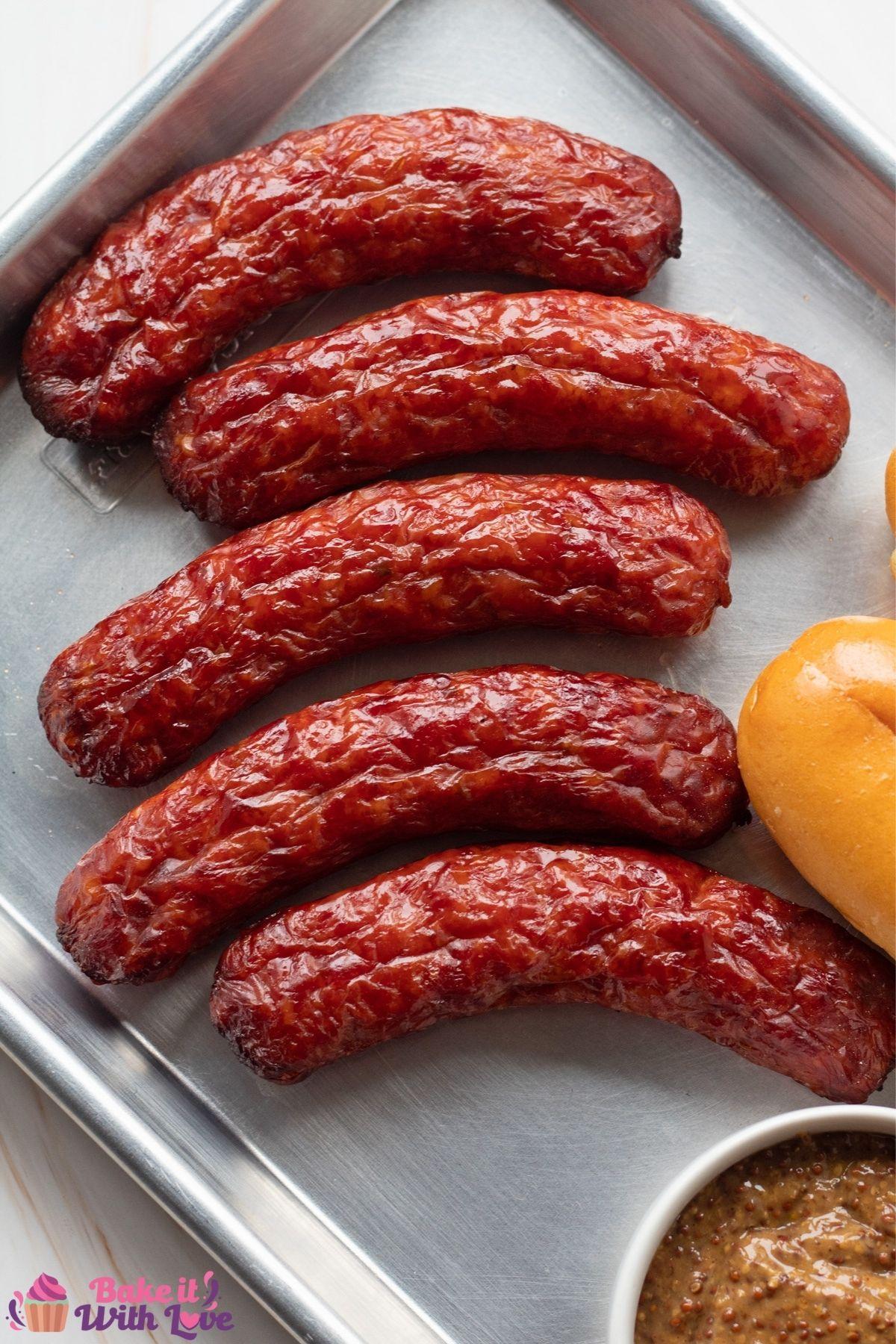 Tall overhead image of the smoked italian sausage on metal tray.