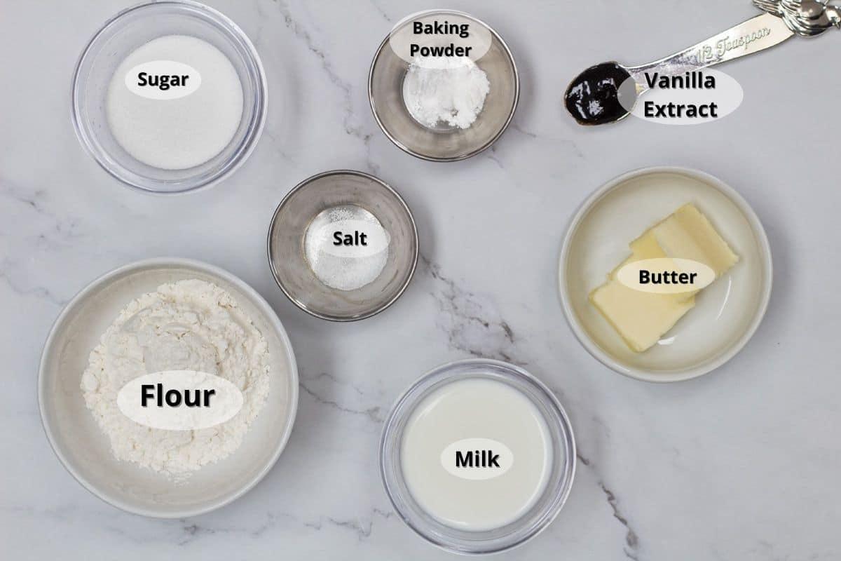 Vanilla mug cake ingredients with labels.
