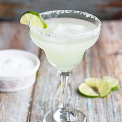 Vodka margarita in margarita glass with salt and lime.