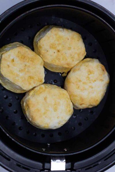 Process photo 2 halfway cooked air fryer biscuits to flip.