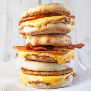Breakfast sandwich variety with 3 sandwiches stacked.