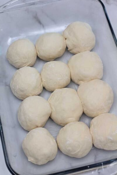 Process photo 9 of the shaped rolls in greased baking pan to rise again.