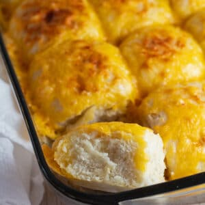 Cheese rolls baked until golden brown and shown here as they are cooling in the pan.