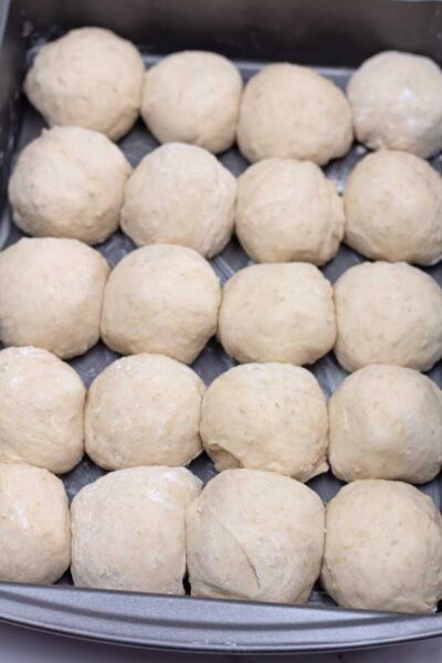 Process photo 9 of the portioned and shape balls of dough.