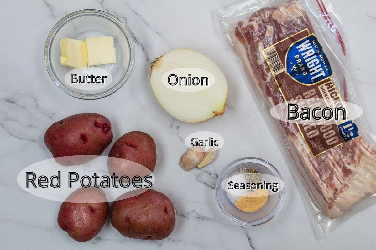 Ingredient photo showing potatoes, butter, onion, galic, bacon, and seasoning.